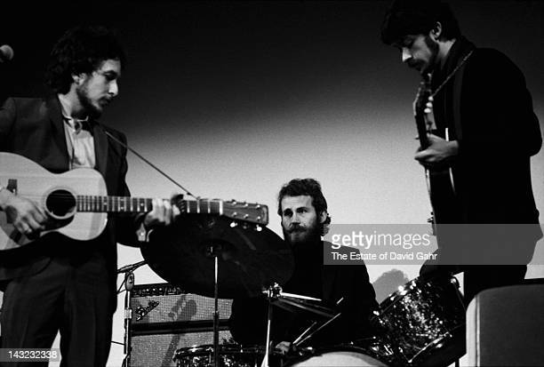 Bob Dylan performs with Levon Helm and Robbie Robertson at the Woody Guthrie Memorial Concert on January 20 1968 at Carnegie Hall in New York City...