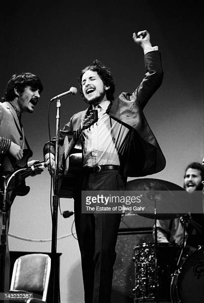 Bob Dylan performs with Rick Danko and Levon Helm at the Woody Guthrie Memorial Concert on January 20 1968 at Carnegie Hall in New York City New York
