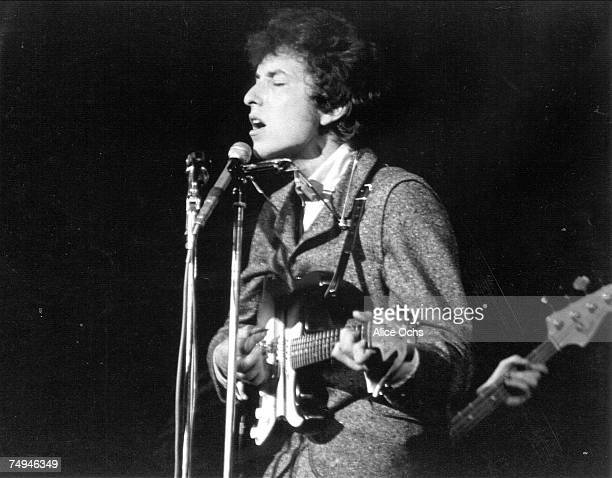 Bob Dylan plays a Fender Stratocaster electric guitar as he performs on stage at the Island Garden on February 26 1966 in Hempstead New York