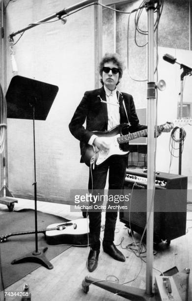 Bob Dylan plays a Fender Stratocaster electric guitar through an Ampeg amplifier while recording his album 'Bringing It All Back Home' on January...
