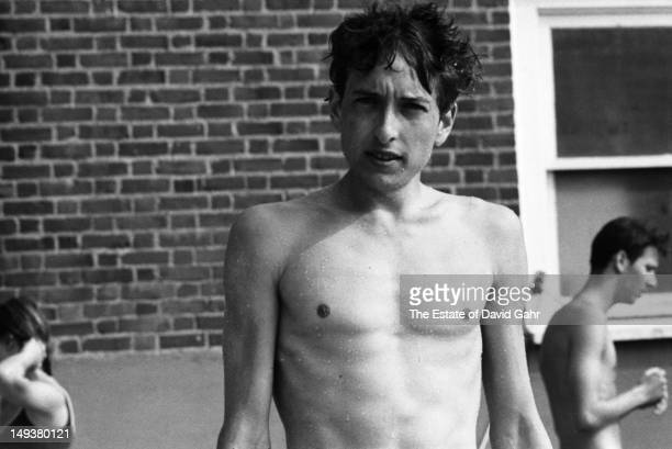Bob Dylan poses for a portrait poolside at his accommodations at the Viking Hotel during the Newport Folk Festival in July 1963 in Newport Rhode...