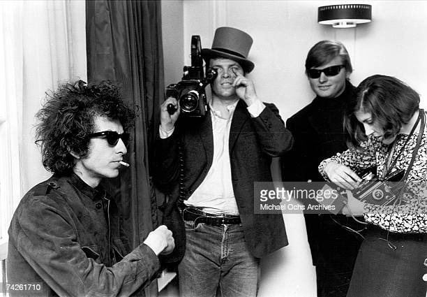Bob Dylan smokes a cigarette as DA Pennebaker films for the documentary film 'Don't Look Back' about Dylan's 1965 tour of England