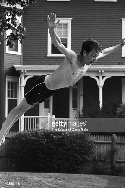 Bob Dylan takes a dive into the pool at the Viking Hotel during the Newport Folk Festival in July 1963 in Newport Rhode Island