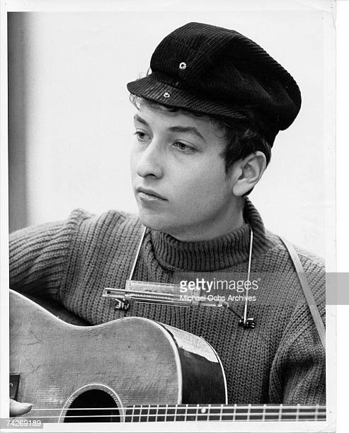 Bob Dylan wearing a motorcycle hat playing guitar in Columbia Recording Studio for a session in September 1961 in New York City, New York.