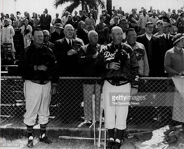 Bob Elliott Eddie Rickenbacker Giles Owner Walter O'Malley and Manger Walter Alston of the Brooklyn Dodgers prior ro a spring training game on March...