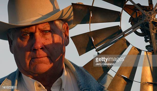 LAMAR COLO DECEMBER 3 2003 Bob Emick <cq> stands with a 100yearold salesman's model of a windmill outside his ranch house Thursday afternoon 12/4/04...