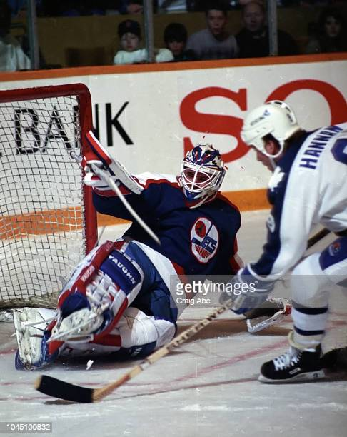 Bob Essensa of the Winnipeg Jets skates against Dave Hannan of the Toronto Maple Leafs during NHL game action on March 17 1990 at Air Canada Centre...