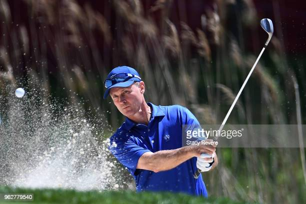 Bob Estes hits from a green side bunker on the 17th hole during the third round of the Senior PGA Championship presented by KitchenAid at the Golf...
