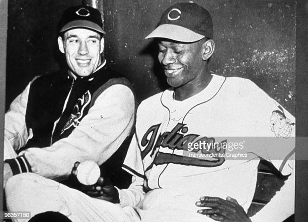 Bob Feller, left, and Satchel Paige, pitchers for the Cleveland Indians in 1949 pose for a photo in the Indians dugout.