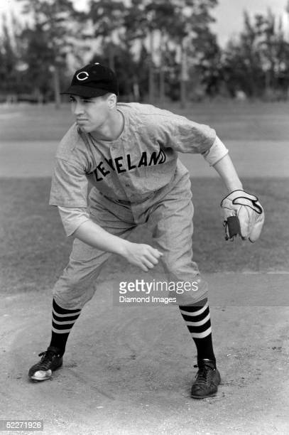 Bob Feller pitcher for the Cleveland Indians poses for an action portrait during March 1940 Spring Training in Florida