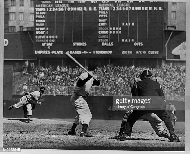 Bob Feller throws to Joe DiMaggio, during his April 30, 1946 no-hitter at Yankee Stadium.