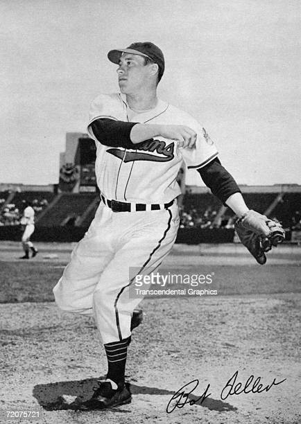 Bob Feller warms up before a game at Municipal Stadium in Cleveland for this 1949 autographed premium