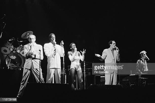Bob Fish, Kenny Andrews, Rita Ray, Griff Fender and Hammy Howell of Darts on stage during a live concert performance by the British doo-wop revival...