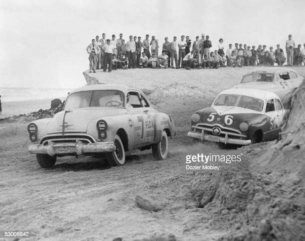 Bob Flock leads the way out of the south turn in his 1949 Oldsmobile at the Beach and Road Course race on February 5 1950 in Daytona Beach FL Flock...