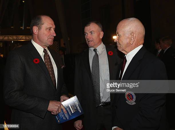 Bob Gainey Dave Keon Jr and Dave Keon walk the red carpet prior to the 2013 Hockey Hall of Fame induction ceremony on November 11 2013 in Toronto...