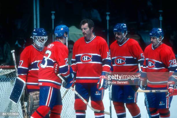 Bob Gainey Larry Robinson Rick Green Jean Hamel and goalie Steve Penney of the Montreal Canadiens meet on the ice during the 1984 Conference Finals...