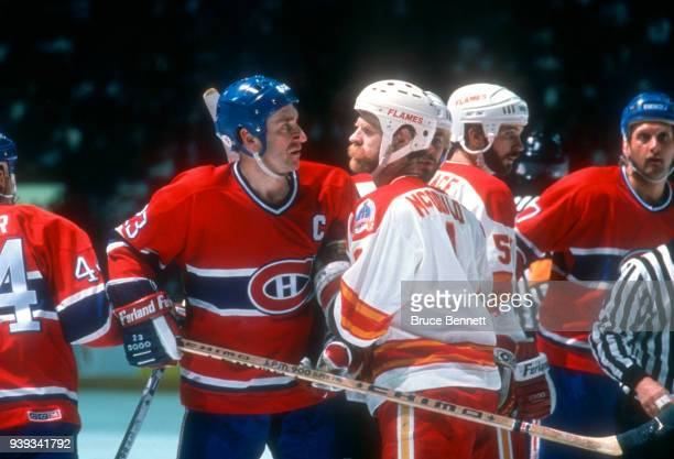 Bob Gainey of the Montreal Canadiens and Lanny McDonald of the Calgary Flames argue during the 1989 Stanley Cup Finals circa May 1989 at the Olympic...