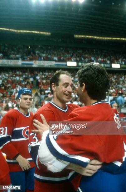 Bob Gainey of the Montreal Canadiens hugs teammate and goalie Doug Soetaert after the Canadiens defeated the Calgary Flames in Game 5 of the 1986...