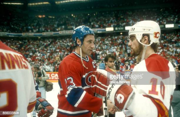 Bob Gainey of the Montreal Canadiens shakes hands with Dan Quinn of the Calgary Flames after the Canadiens defeated the Flames in Game 5 of the 1986...