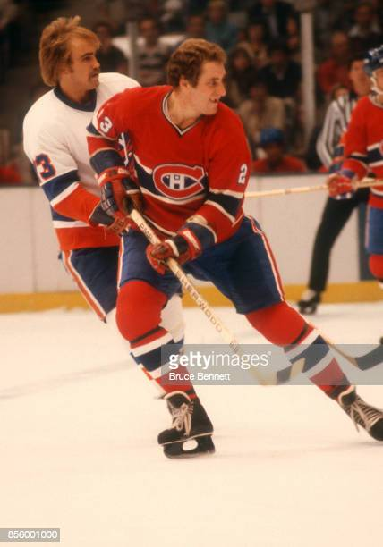 Bob Gainey of the Montreal Canadiens skates on the ice as he is defended by Bob Nystrom of the New York Islanders during an NHL game on October 17...
