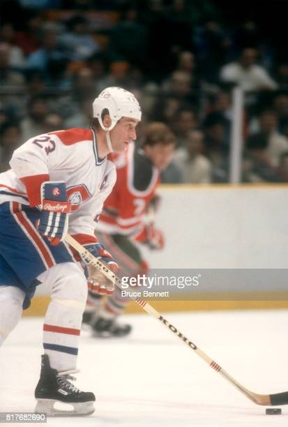 Bob Gainey of the Montreal Canadiens skates on the ice with the puck during an NHL game against the New Jersey Devils on December 27 1985 at the...