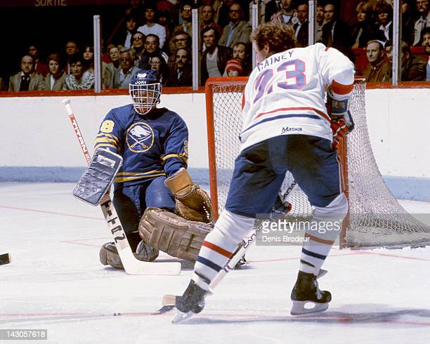 Bob Gainey of the Montreal Canadiens skates skates to the front of the net to look for a loose puck near Bob Sauve of the Buffalo Sabres Circa 1980...