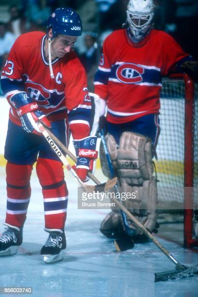 Bob Gainey of the Montreal Canadiens squeegees off the extra water during an NHL game against the New York Islanders on November 12 1985 at the...