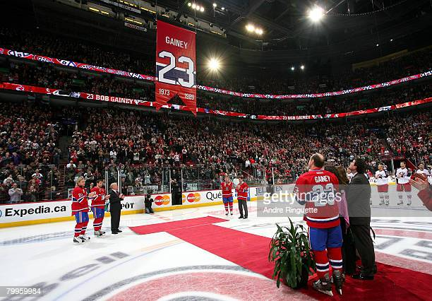 Bob Gainey of the Montreal Canadiens watches a banner with his number 23 be raised to the rafters during his jersey retirement ceremony prior to a...