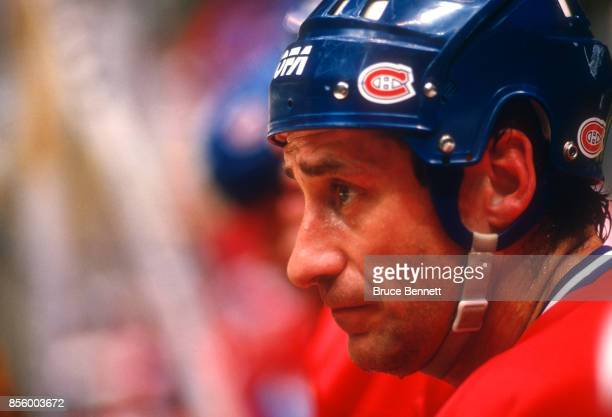 Bob Gainey of the Montreal Canadiens watches the action from the bench during an NHL game against the New Jersey Devils on October 16 1987 at the...