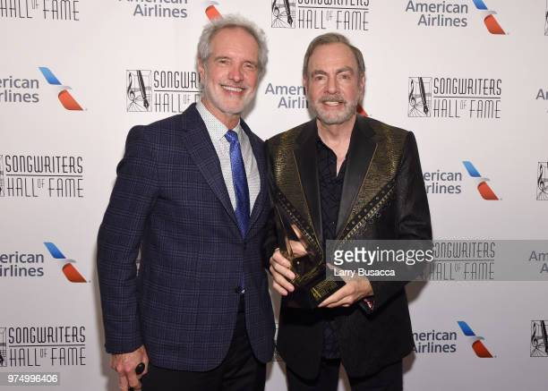 Bob Gaudio and Neil Diamond pose backstage during the Songwriters Hall of Fame 49th Annual Induction and Awards Dinner at New York Marriott Marquis...