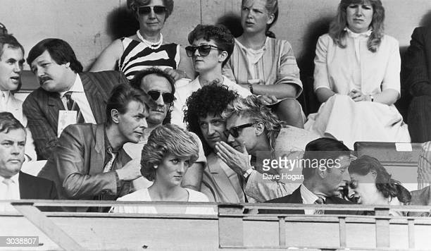 Bob Geldof has a word with Prince Charles while David Bowie chats with Roger Taylor and Brian May of Queen during the Live Aid Concert at Wembley...