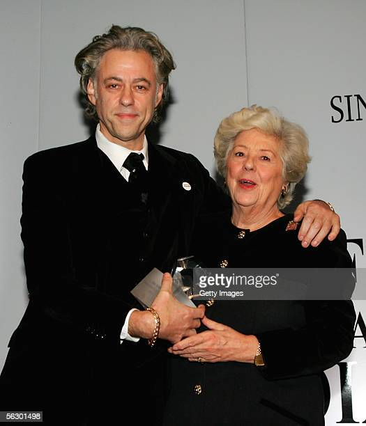 Bob Geldof holds his award for Communicator of the Year as he stands with former Speaker of the House Betty Boothroyd during the Foreign Press...