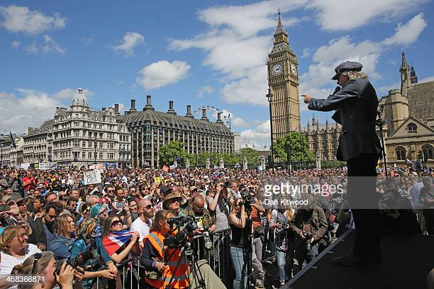 Bob Geldof speaks as tens of thousands of people gather in Parliament Square to listen to speakers after marching through central London in a 'March...