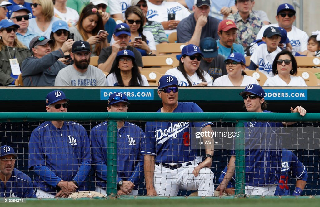 Bob Geren #8 of the Los Angeles Dodgers watches from the dugout in the eighth inning against the Seattle Mariners during the spring training game at Camelback Ranch on March 5, 2017 in Glendale, Arizona.
