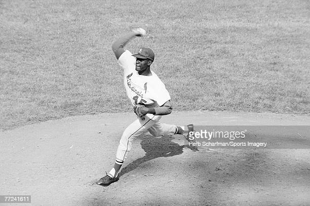 Bob Gibson of the St Louis Cardinals pitching during Game 7 of the 1964 World Series against the New York Yankees on October 15 1964 in St Louis...