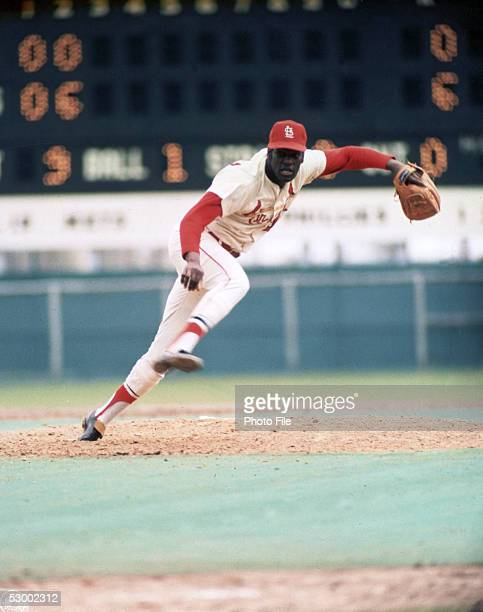Bob Gibson of the StLouis Cardinals makes a throw during a season game Bob Gibson played for the StLouis Cardinals from 19591975