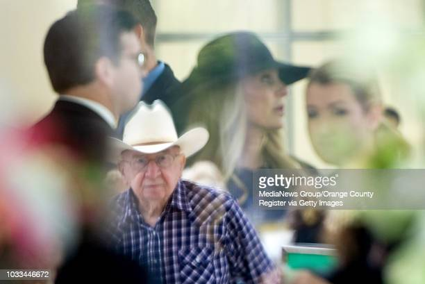 Bob Goellner and his cowboy hat is reflected in the window of a room where relatives of Robert H. Schuller gather. The Crystal Cathedral founder was...