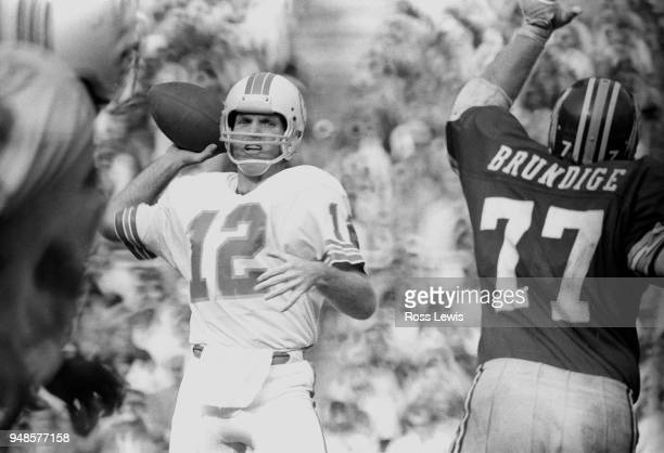 Bob Griese of Miami Dolphins passing against Washington Redskins on October 13 1974 in Washington DC