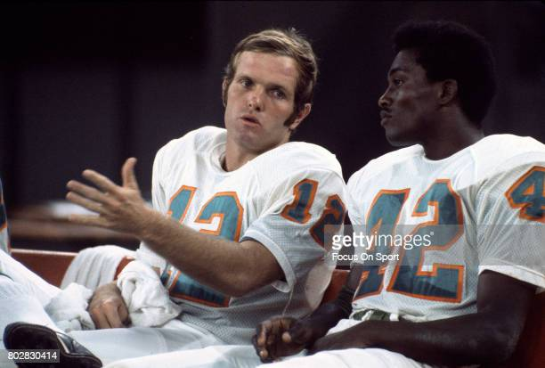 Bob Griese of the Miami Dolphins talks with receiver Paul Warfield during an NFL game circa 1970 at the Orange Bowl in Miami, Florida. Griese played...