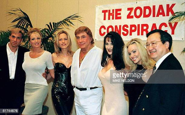 Bob Guccione Penthouse magazine publisher poses 06 March in Santa Monica California with his coproducer and actors and Penthouse Pets who will star...