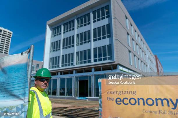 Bob Hancock works as a security guard at the site of Stockton University's new campus and dorm buildings constructed along the boardwalk on June 29...