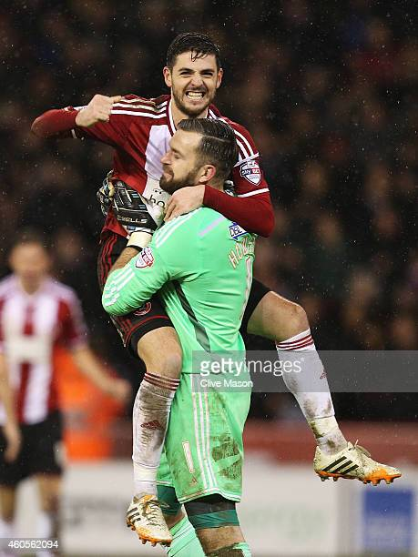 Bob Harris of Sheffield United celebrates victory with Mark Howard of Sheffield United after the Capital One Cup QuarterFinal match between Sheffield...