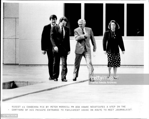 PM Bob Hawke negotiates a step in the cortyard of his private entrance to Parliament House on route to meet journalistL to R Federal Policeman Grant...