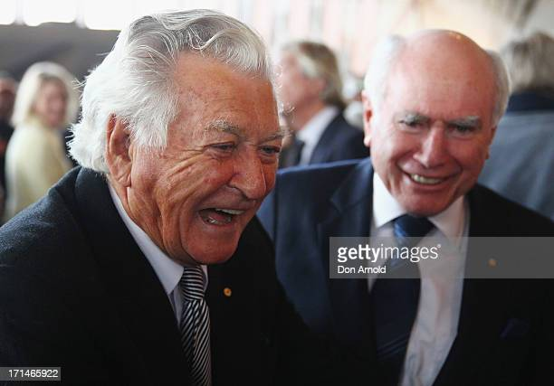Bob Hawke talks with John Howard as they attend a state memorial service for the late Hazel Hawke exwife of former Australian Prime Minister Bob...