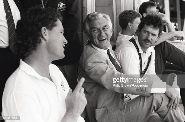 Bob Hawke the Prime Minister of Australia sits on the dressing room balcony laughing with Dean Jones and captain Allan Border during play at the 2nd...