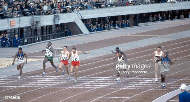 Bob Hayes of the United States wins the men's 100 metres event during the Summer Olympic Games in Tokyo circa October 1964 In second place is Enrique...