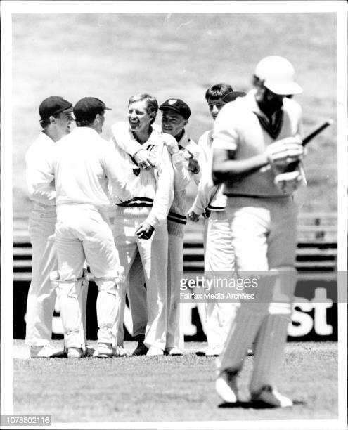 Bob Holland gets a hug from Greg Matthews and congratulations from his other NSW team mates after dismissing New Zealand captain Jeremy Coney...