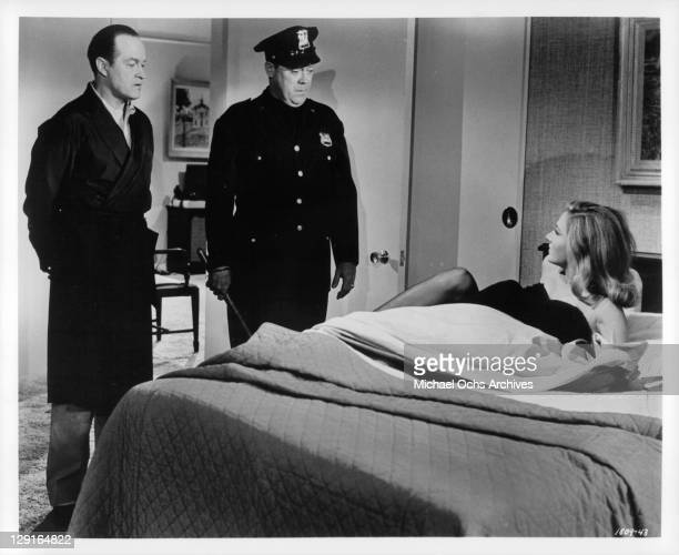 Bob Hope And officer find Elga Andersen in his bed in a scene from the film 'A Global Affair' 1964