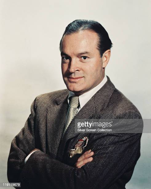 Bob Hope British actor and comedian wearing a herringbone jacket in a studio portrait against a white background circa 1955