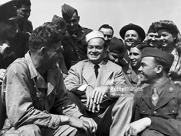 Bob Hope jokes with a group of soldiers in England 1943